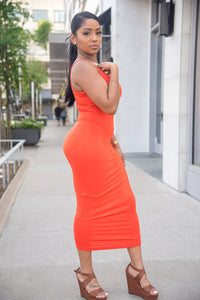 Orange, knit lounge maxi dress featuring a stretchy fabric, round neckline, sleeveless, no closure.