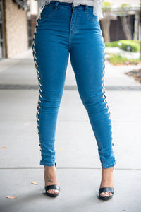 Skinny Jean with lace up detail featuring an open side hand punching eyelet.  EXCELLENT STRETCH DENIM.