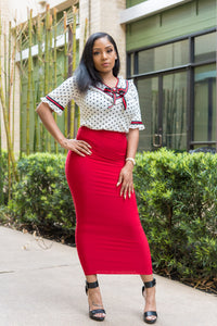White Polka Dot Top featuring red and black lined detail and a ruby red brooch thats detachable.