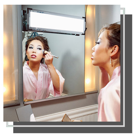 Woman applying blush in front of mirror with Eyelight