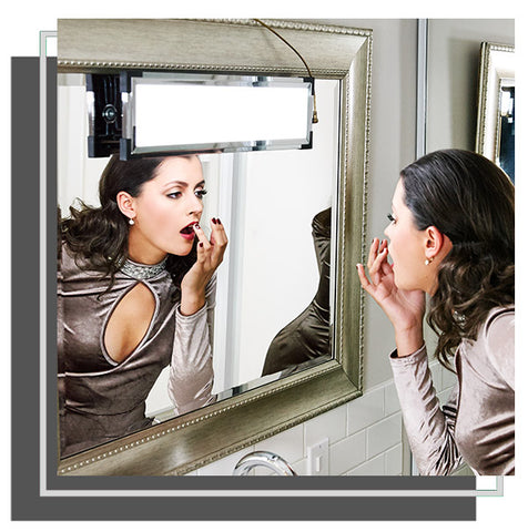 Woman adjusting her lipstick in mirror with Eyelight