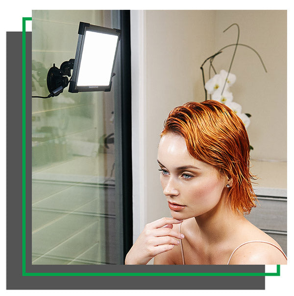 Model in front of Key Light on a Suction Mount on glass