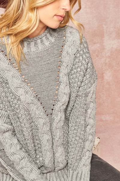Get It Twisted Multi Cable Knit Sweater