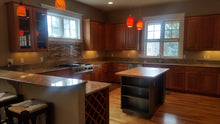 Large frameless Cherry Kitchen with Soft-Close Dovetailed Rollout Trays and Viking Appliances