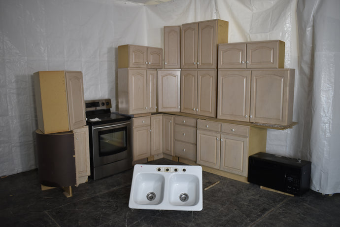 Whitewashed Oak Kitchen Cabinets with two Lazy Susans, Range, Microwave, and Sink