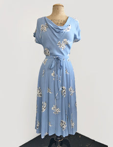 1930s Day Dresses, Afternoon Dresses History Vintage Style Powder Blue Stencil Floral Megan Cowl Neck Dress $148.00 AT vintagedancer.com