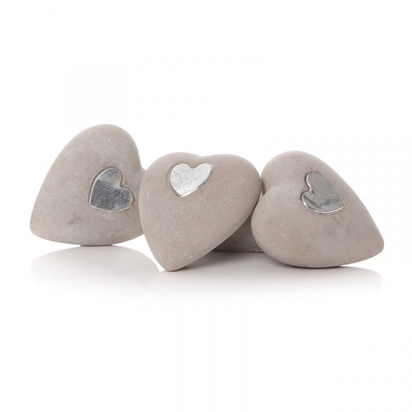 stone hearts inlaid with silver heart