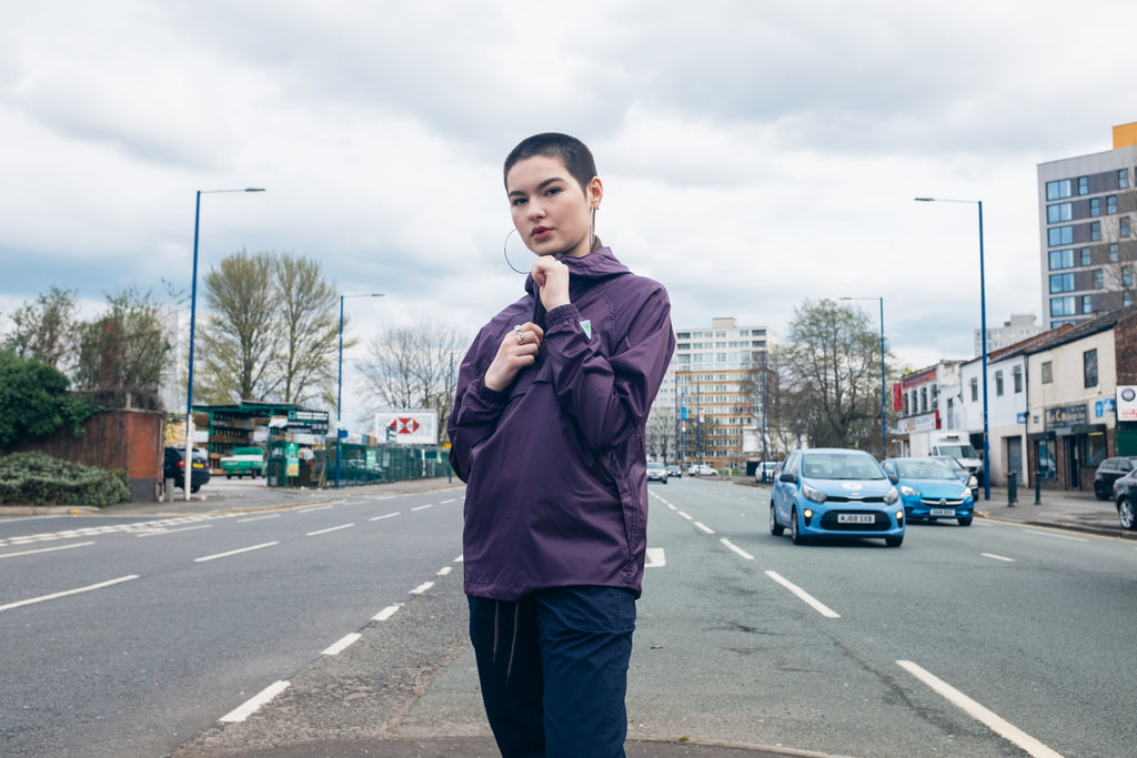 Girl Wearing Hikerdelic Track Top, Colour Purple