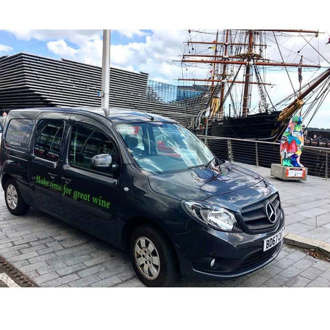The Aitkens van delivering to Discovery Point infront of the new V & A Museum