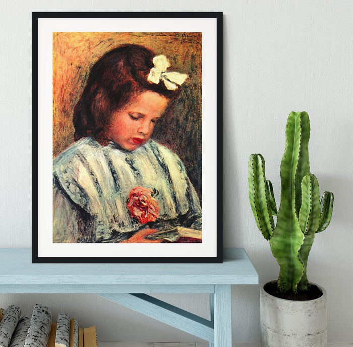 A reading girl by Renoir Framed Print