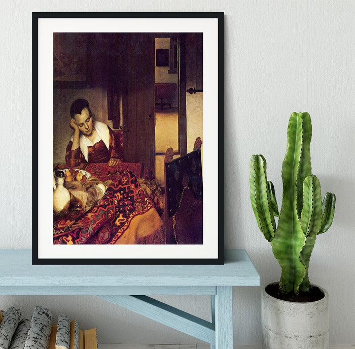 A woman asleep by Vermeer Framed Print