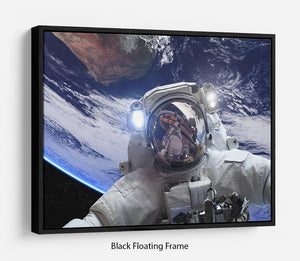 Astronaut in outer space against the backdrop Floating Frame Canvas