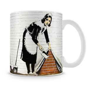 Banksy Maid Sweeping Under the Carpet Mug - Canvas Art Rocks