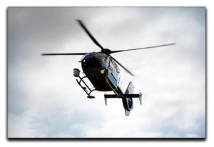 Blue and silver police helicopter flying above Canvas Print or Poster  - Canvas Art Rocks - 1