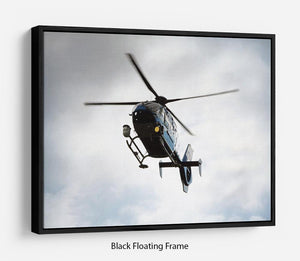 Blue and silver police helicopter flying above Floating Frame Canvas