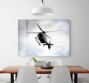 Blue and silver police helicopter flying above HD Metal Print