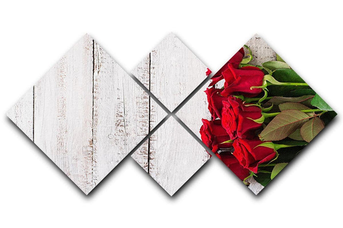 Bouquet of red roses on a light wooden background 4 Square Multi Panel Canvas