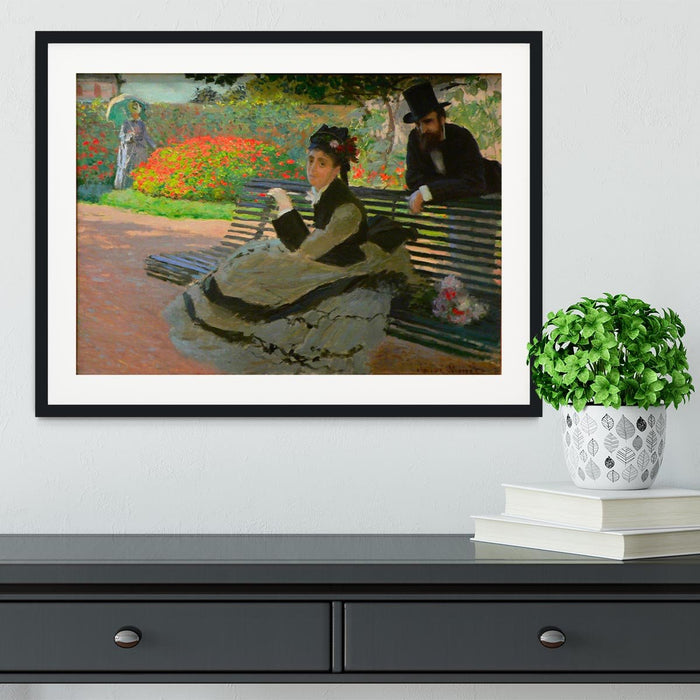Camille Monet on a garden bench by Monet Framed Print