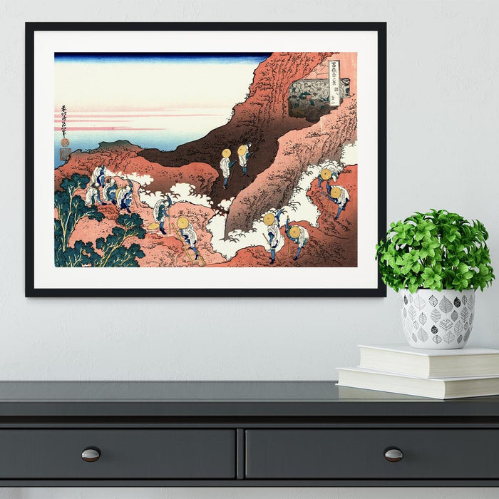 Climbing on Mt. Fuji by Hokusai Framed Print