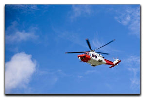 Coastguard helicopter in the blue sky Canvas Print or Poster  - Canvas Art Rocks - 1