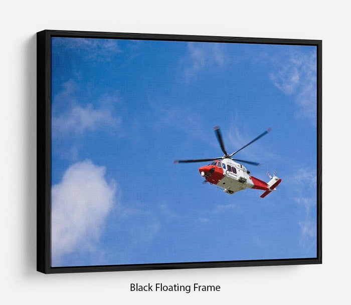 Coastguard helicopter in the blue sky Floating Frame Canvas