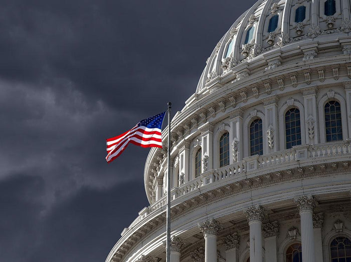 Dark sky over the US Capitol building Wall Mural Wallpaper
