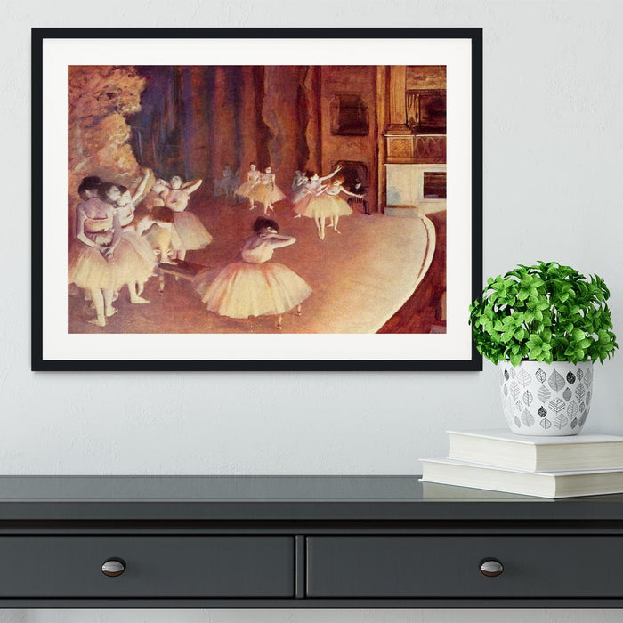 Dress rehearsal of the ballet on the stage by Degas Framed Print