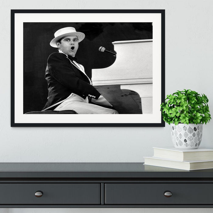 Elton John at the piano Framed Print