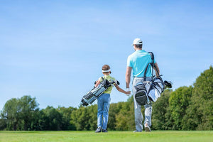 Father and son on golf course Wall Mural Wallpaper - Canvas Art Rocks - 1