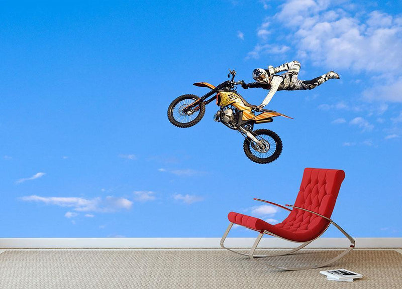 Flying biker on a blue sky background Wall Mural Wallpaper - Canvas Art Rocks - 1