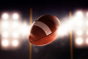 Football ball flying fast through the air Wall Mural Wallpaper - Canvas Art Rocks - 1