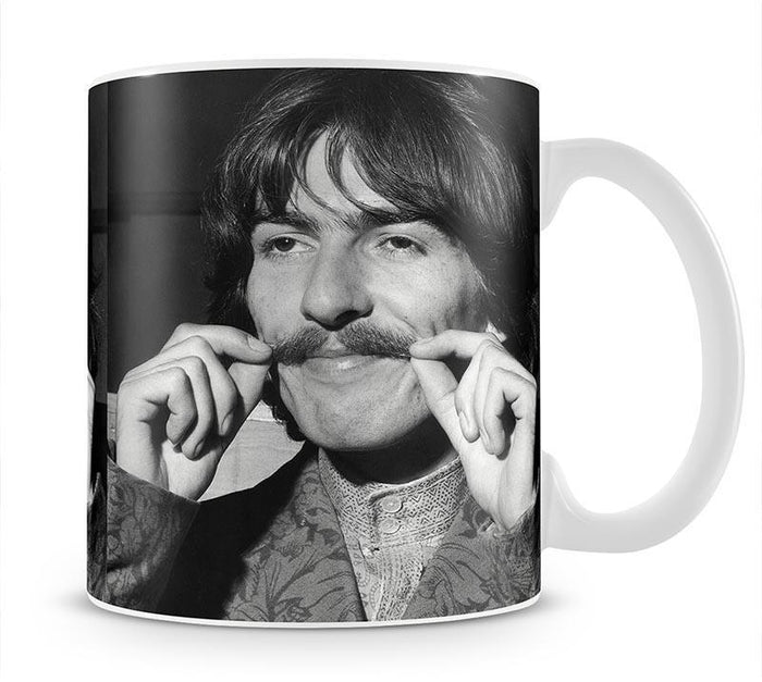 George Harrison plays with his moustache Mug