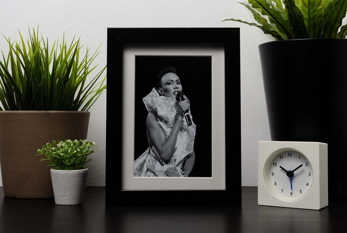 Grace Jones singing Framed Print