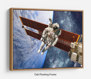 International Space Station and astronaut Floating Frame Canvas