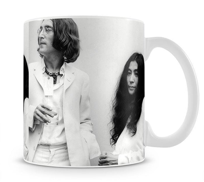 John Lennon and Yoko Ono at an exhibition Mug