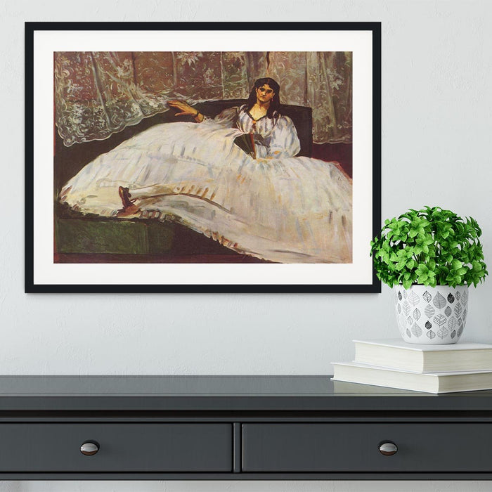 Lady with fan by Manet Framed Print