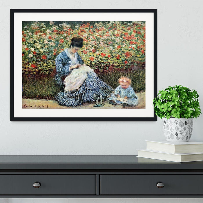 Madame Monet and child by Monet Framed Print