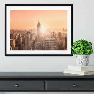Manhattan downtown skyline with illuminated Empire State Building Framed Print - Canvas Art Rocks - 1
