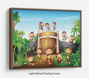 Monkeys having fun at the gate Floating Frame Canvas
