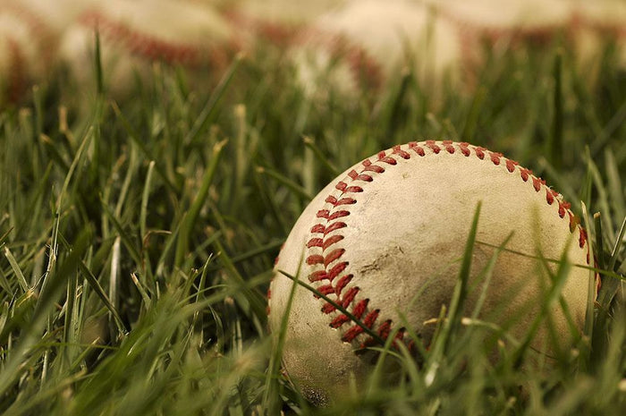 Nostalgic baseballs in the grass Wall Mural Wallpaper