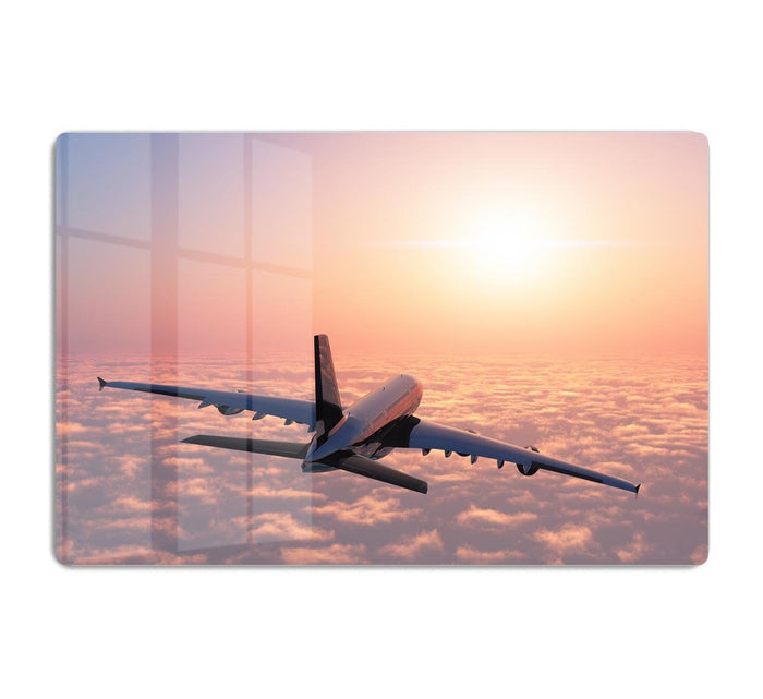 Passenger plane above the clouds HD Metal Print