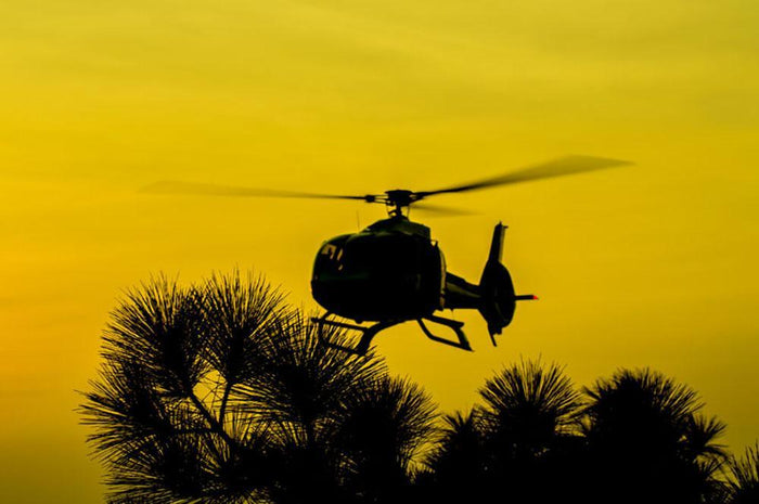 Patrol Helicopter flying in the sky Wall Mural Wallpaper
