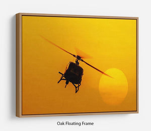 Patrol helicopter flying in sunset Floating Frame Canvas