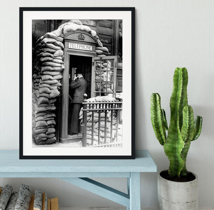 Phone box with sandbags Framed Print