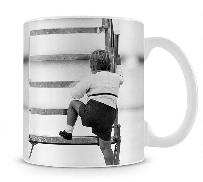 Prince William at Aberdeen Airport climbing stairs Mug