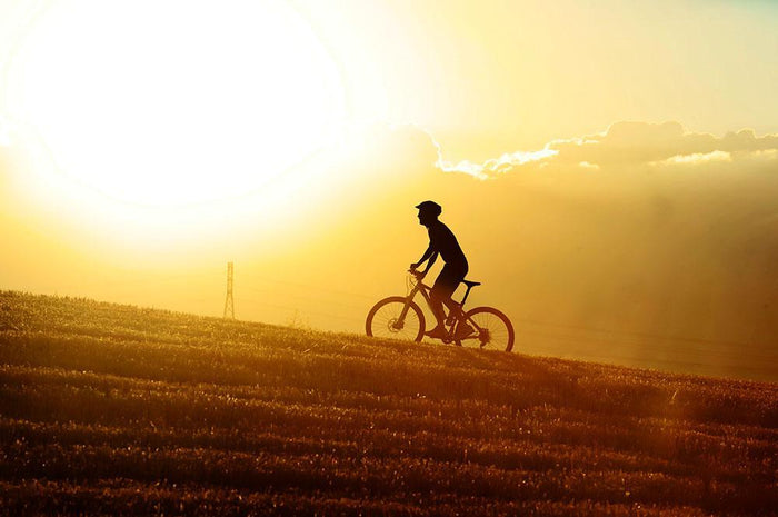 Profile silhouette of sport man cycling Wall Mural Wallpaper