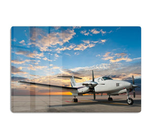 Propeller plane parking at the airport HD Metal Print