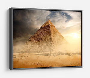 Pyramid in sand dust under clouds HD Metal Print