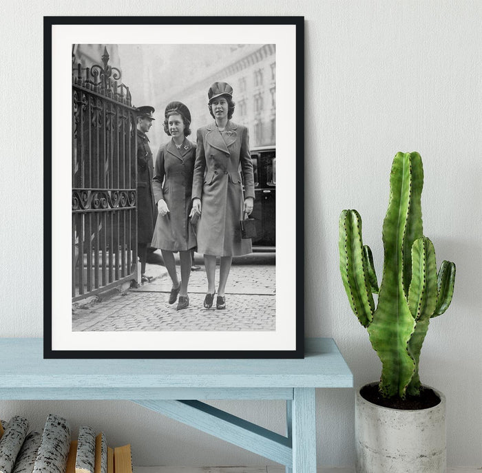 Queen Elizabeth II with Princess Margaret arriving at a wedding Framed Print