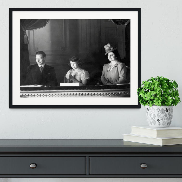 Queen Elizabeth II with her parents entranced viewing the stage Framed Print